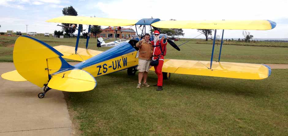 Father Christmas in a Tiger Moth
